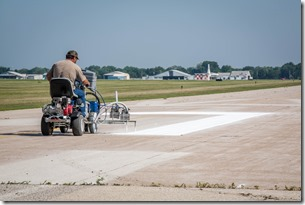 AirVenture preparation includes painting temporary markings on taxiway Alpha, turning it into Runway 18 Left/36 Right.